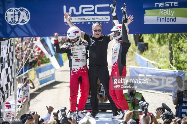 Toyota Team Principal Finnish Tommi Mäkinen celebrates with his winners driver Esapekka Lappi and copilot Janne Färm of Finland after placing first...