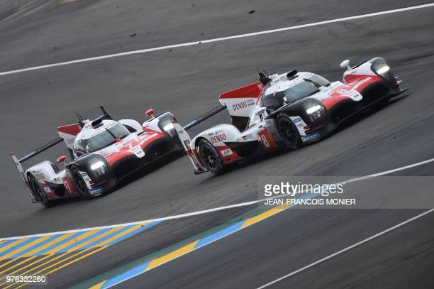 Toyota TS050 Hybrid LMP1 Spain's driver Fernando Alonso competes ahead of the Toyota TS050 Hybrid LMP1 driven by Argentine's Jose Maria Lopez during...