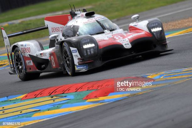 TOPSHOT Toyota TS050 Hybrid LMP1 Spain's driver Fernando Alonso competes during the 86th edition of the 24h du Mans car endurance race in Le Mans...