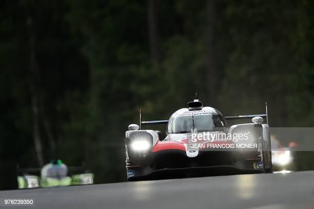 TOPSHOT Toyota TS050 Hybrid LMP1 Spain's driver Fernando Alonso leads during the 86th Le Mans 24hours endurance race at the Circuit de la Sarthe on...