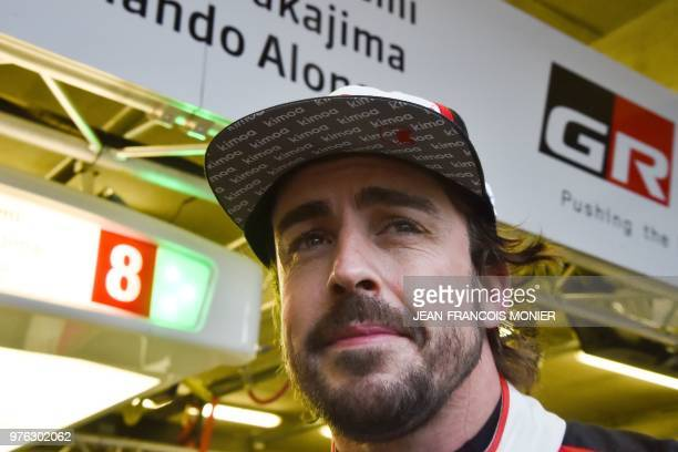Toyota TS050 Hybrid LMP1 Spain's driver Fernando Alonso reacts in the pits following a relay during the 86th Le Mans 24hours endurance race at the...