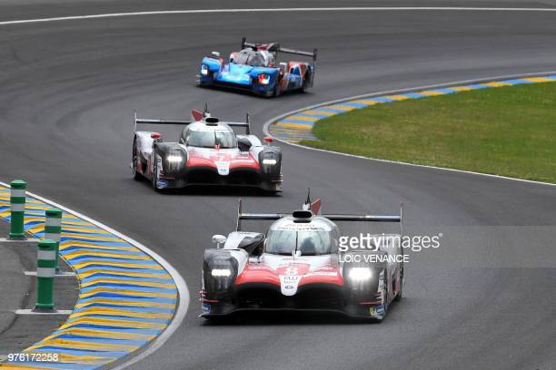 Toyota TS050 Hybrid LMP1 Swiss driver Sebastien Buemi leads the pack ahead of Toyota TS050 Hybrid LMP1 British's driver Mike Conway BR Engineering...
