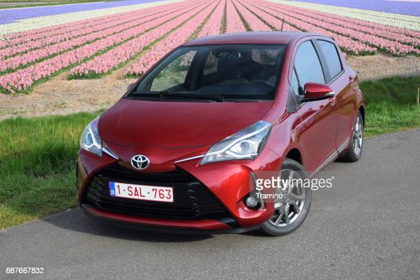 toyota yaris hybrid on the road - hybrid vehicle stock photos and pictures