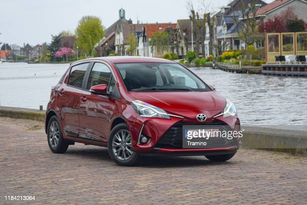 toyota yaris hybrid on the street - toyota motor co stock pictures, royalty-free photos & images