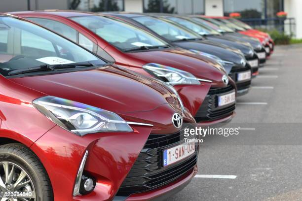 toyota yaris hybrid vehicles on the parking - toyota motor co stock pictures, royalty-free photos & images
