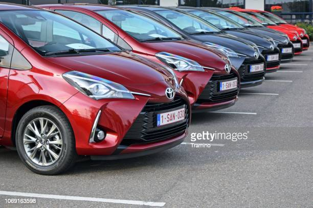 toyota yaris vehicles on the parking - domestic car stock pictures, royalty-free photos & images