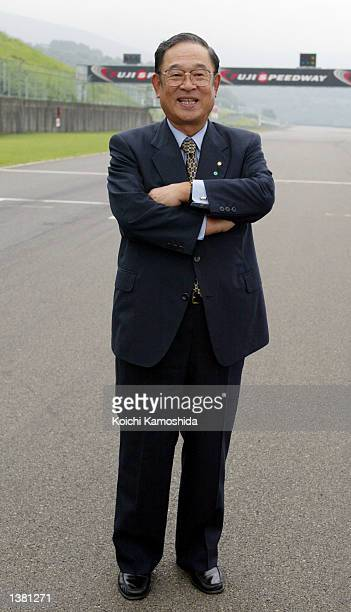 Toyota's CEO Fujio Cho poses at the Fuji Speedway September 13 2002 in Shizuoka Prefecture Japan Toyota's new car the Caldina is a medium class wagon...