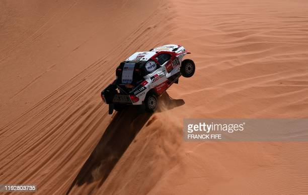 Toyota's driver Fernando Alonso of Spain and codriver Marc Coma of Spain compete during the Stage 6 of the Dakar 2020 between Ha'il and Riyadh Saudi...
