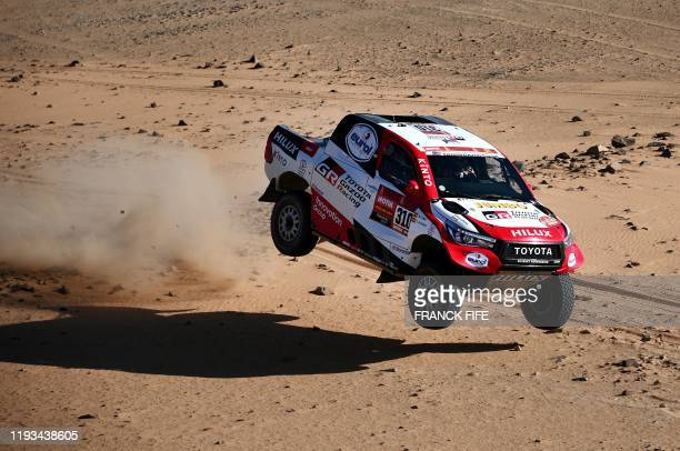 TOPSHOT Toyota's driver Fernando Alonso of Spain and codriver Marc Coma of Spain compete in the Stage 8 of the Dakar 2020 around Wadi AdDawasir on...