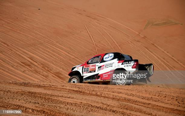 Toyota's driver Fernando Alonso of Spain and codriver Marc Coma of Spain compete during the Stage 11 of the Dakar 2020 between Shubaytah and Haradh...