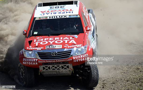 Toyota's driver Giniel De Villiers of South Africa and codriver Dirk Von Zitzewitz of Germany compete during the 2015 Dakar Rally stage 1 between...