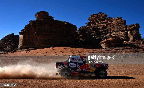 Toyota's driver Giniel De Villiers of South Africa and his codriver Alex Bravo Haro of Spain compete during the Stage 3 of the Dakar 2020 around Neom...