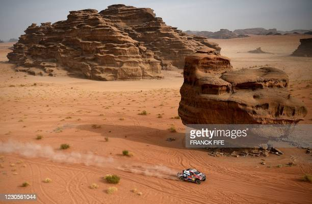 Toyota's driver Giniel De Villiers of South Africa and his co-driver Alex Bravo Haro of Spain compete during the Stage 10 of the Dakar 2021 between...