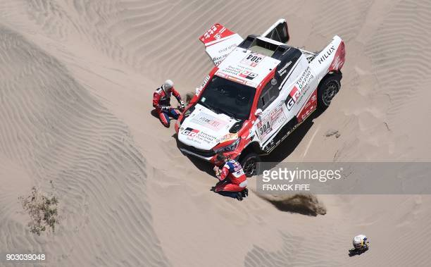 TOPSHOT Toyota's driver Giniel De Villiers of South Africa and his codriver Dirk Von Zitzewitz of Germany are pictured during Stage 4 of the Dakar...