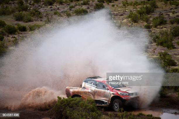 TOPSHOT Toyota's driver Giniel De Villiers of South Africa and his codriver Dirk Von Zitzewitz of Germany compete during Stage 7 of the 2018 Dakar...