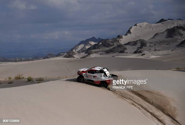 Toyota's driver Giniel De Villiers of South Africa and his codriver Dirk Von Zitzewitz of Germany compete during the Stage 11 of the 2018 Dakar Rally...