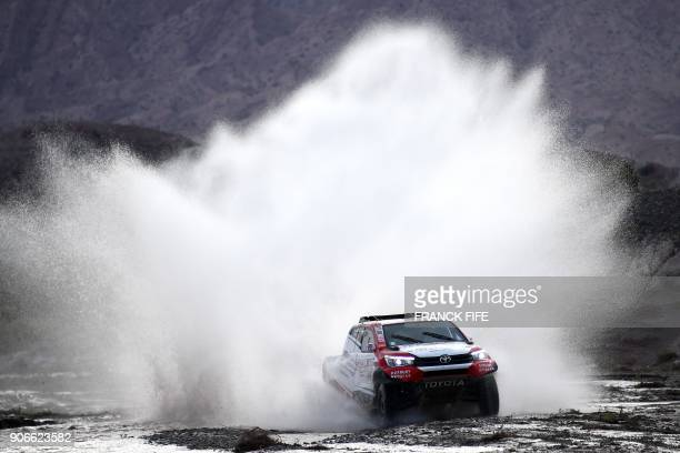 Toyota's driver Giniel De Villiers of South Africa and his codriver Dirk Von Zitzewitz of Germany compete during the Stage 12 of the 2018 Dakar Rally...