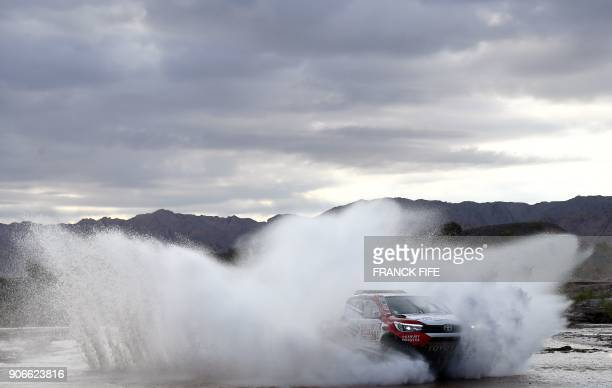 TOPSHOT Toyota's driver Giniel De Villiers of South Africa and his codriver Dirk Von Zitzewitz of Germany compete during the Stage 12 of the 2018...