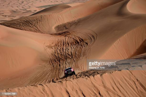 Toyota's driver Nasser AlAttiyah of Qatar and his codriver Mathieu Baumel of France compete during the Stage 11 of the Dakar 2020 between Shubaytah...