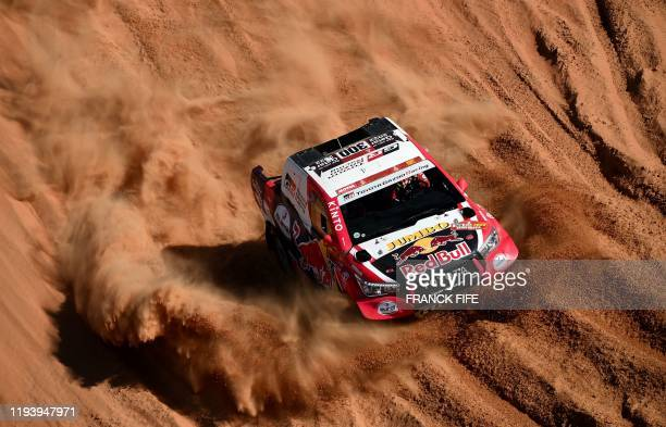 Toyota's driver Nasser Al-Attiyah of Qatar and his co-driver Mathieu Baumel of France compete during the Stage 11 of the Dakar 2020 between Shubaytah...