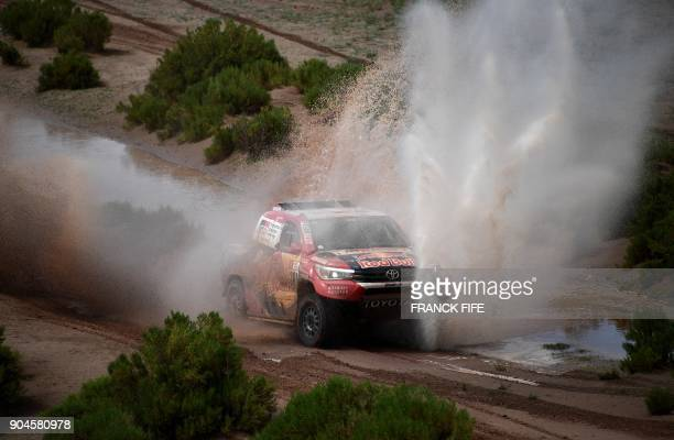 Toyota's driver Nasser AlAttiyah of Qatar and his codriver Matthieu Baumel of France compete during Stage 7 of the 2018 Dakar Rally between La Paz...