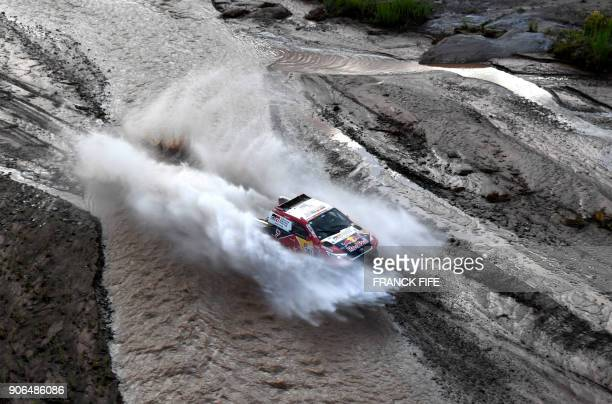 TOPSHOT Toyota's driver Nasser AlAttiyah of Qatar and his codriver Matthieu Baumel of France compete during the Stage 12 of the 2018 Dakar Rally...