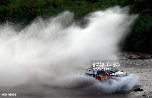 Toyota's driver Nasser AlAttiyah of Qatar and his codriver Matthieu Baumel of France compete during the Stage 12 of the 2018 Dakar Rally between...