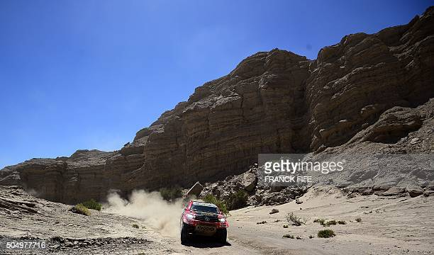 TOPSHOT Toyota's driver Yazeed Alrajhi of Saudi Arabia and codriver Timo Gottschalk of Germany compete during the Stage 11 of the Dakar Rally 2016...