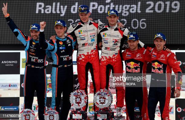Toyota's Estonian driver Ott Tanak and Estonian codriver Martin Jarveoja celebrate after winning the 2019 Rally of Portugal ahead of Hyundai's...