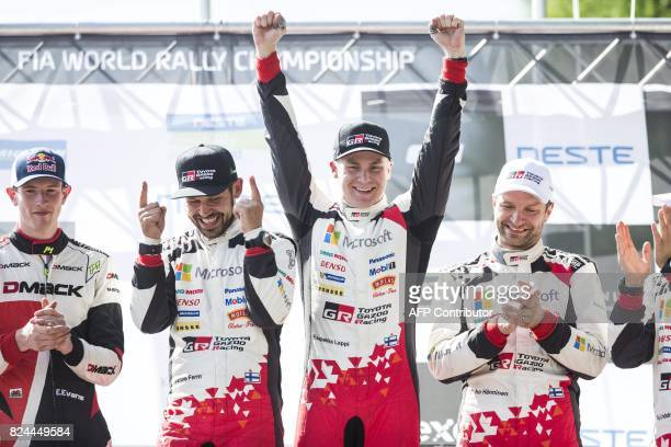 Toyota's Finnish driver Esapekka Lappi and copilot Janne Färm celebrate on podium after winning the Neste Rally Finland 2017 in Jyväskylä central...