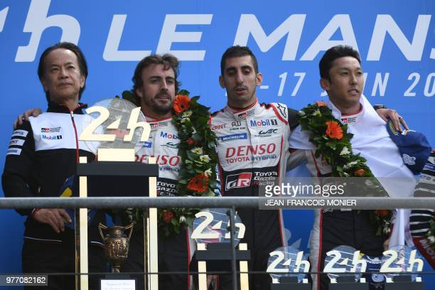 Toyota's head of motorsport Shigeki Tomoyama Spain's driver Fernando Alonso Switzerland's Sebastien Buemi and Japan's Kazuki Nakajima pose on the...