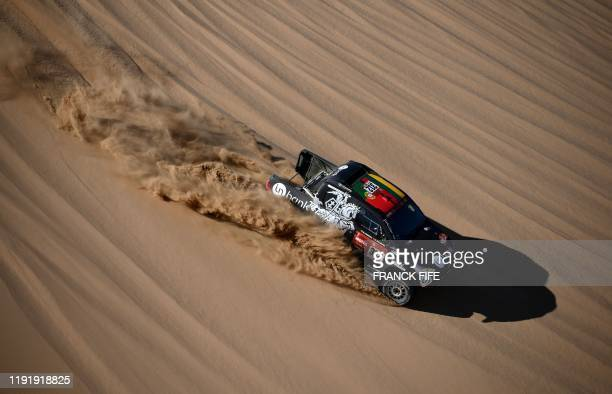 Toyota's Hilux driver Benediktas Vanagas of Lithuania and co-driver Sebastien Rozwadowski of Poland compete during the Stage 1 of the Dakar 2020...