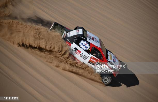Toyota's Hilux Gazoo racing driver Fernando Alonso of Spain and codriver Marc Coma of Spain compete during the Stage 1 of the Dakar 2020 between...