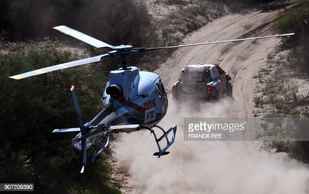 TOPSHOT Toyota's Qatari driver Nasser AlAttiyah and French codriver Mathieu Baumel compete during the 2018 Dakar Rally between San Juan and Cordoba...