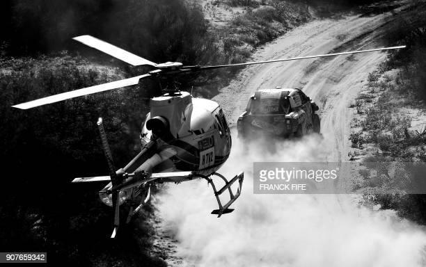 Toyota's Qatari driver Nasser AlAttiyah and French codriver Mathieu Baumel compete during the 2018 Dakar Rally between San Juan and Cordoba in...