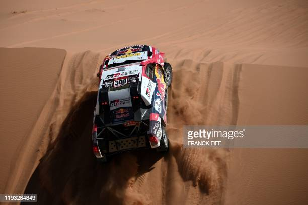 Toyota's Qatari driver Nasser Al-Attiyah and his French co-driver Mathieu Baumel compete in the Stage 7 of the Dakar 2020 between Riyadh and Wadi Al...