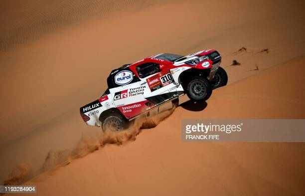 Toyota's Spanish driver Fernando Alonso and codriver Marc Coma compete in the Stage 7 of the Dakar 2020 between Riyadh and Wadi Al Dawasir Saudi...