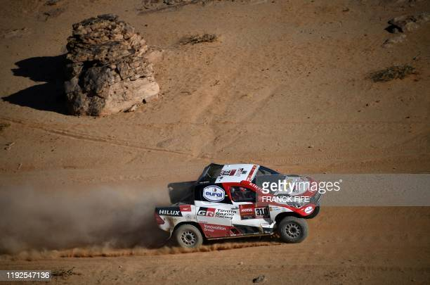 Toyota's Spanish driver Fernando Alonso and Spanish co-driver Marc Coma compete during the Stage 4 of the Dakar 2020 between Neom and Al-Ula, Saudi...