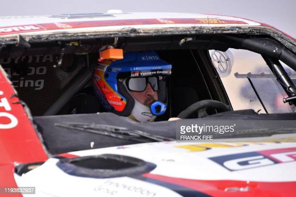 Toyota's Spanish driver Fernando Alonso drives their car after the neutralisation of the race due to strong winds during the Stage 10 of the Dakar...