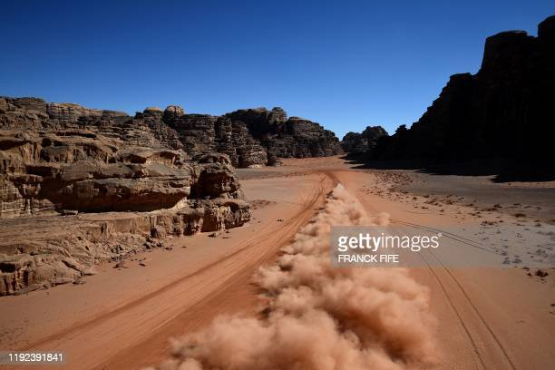 Toyota's Spanish drivers Fernando Alonso and codriver Marc Coma compete during the Stage 3 of the Dakar 2020 around Neom Saudi Arabia on January 7...