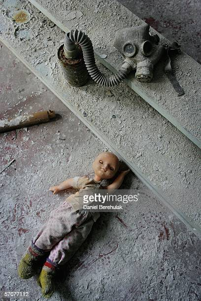 Toys and a gas mask lay in dust in an abandoned pre school in the deserted city of Pripyat on January 25 2006 in Chernobyl Ukraine Prypyat and the...