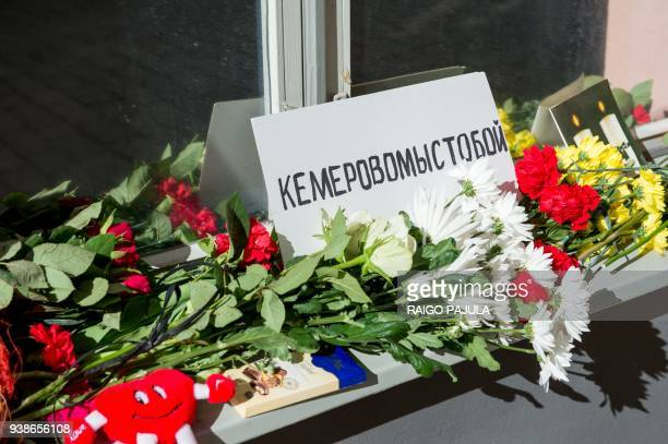 Toys and bounches of flowers lay in front of the Russian Embassy commemorating the fire tragedy victims of the Siberian coalmining city of Kemerovo's...