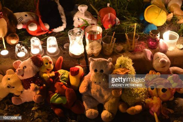 Toys and candles lie near a college in Kerch Crimea on October 17 after a student opened fire at a technical college in the Russianannexed Crimea...
