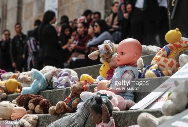 Toys are placed on the steps of the Colombian Congress building to protest against sexual violence against children in Bogota on November 20 2018 The...
