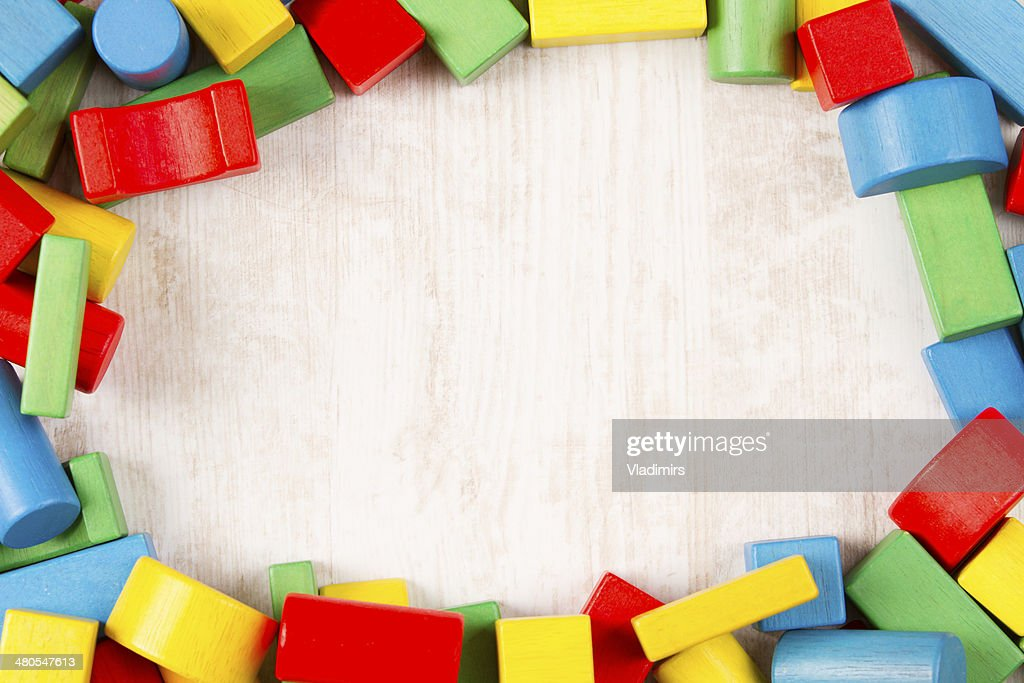 Toys blocks frame, multicolor wooden building bricks : Stock Photo