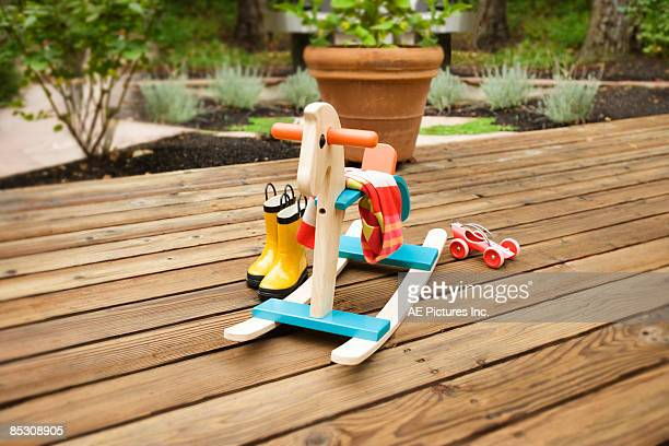 toys, boots and rocking horse on deck - レインブーツ ストックフォトと画像