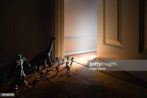 toys by doorway - army soldier toy stock pictures, royalty-free photos & images