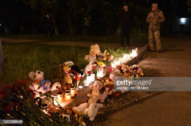 Toys candles and flowers lay near a college in Kerch Crimea on October 17 after a student opened fire at a technical college in the Russianannexed...