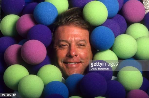 Closeup portrait of Nerf Ball inventor Reynolds Guyer posing with balls all aorund his face during photo shoot Grande FL CREDIT David Bergman