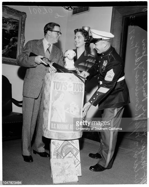 Toys for Tots 27 November 1953 Mayor Norris PoulsonJoan WeldonMaster Sergeant Cornelius Visser Caption slip reads 'Photographer McCarty Date Reporter...